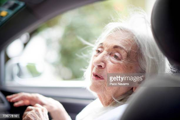 older caucasian woman sitting in car - traditionally hungarian stock pictures, royalty-free photos & images