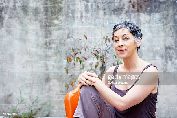 Older Caucasian woman sitting outdoors