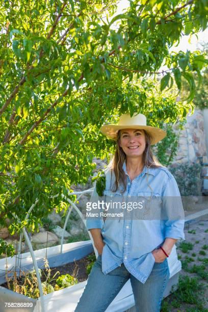 Older Caucasian woman standing in garden