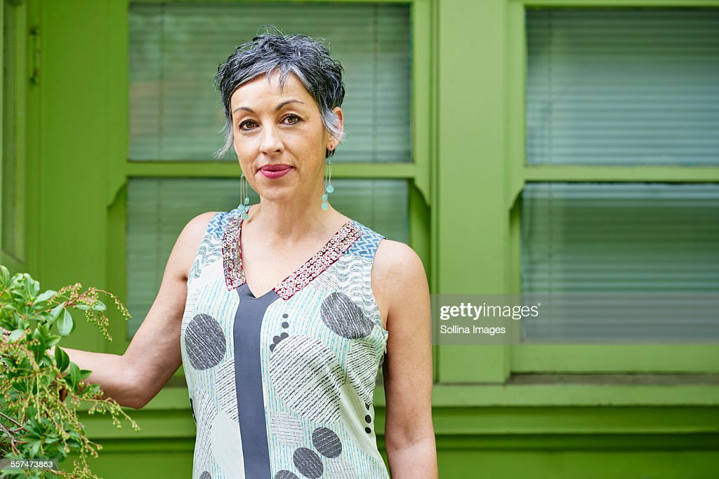 Older Caucasian woman standing outdoors : Stock Photo