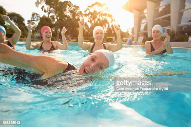 Older Caucasian woman swimming in pool