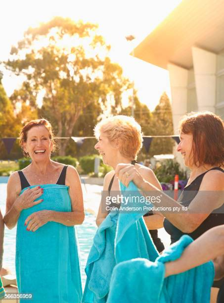 Older Caucasian women drying off at pool