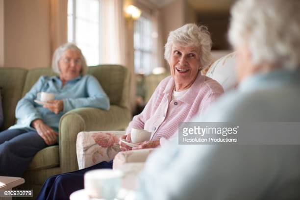 Older Caucasian women talking in nursing home