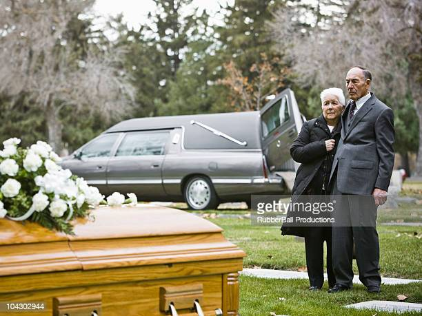 older couple at a funeral - hearse stock pictures, royalty-free photos & images