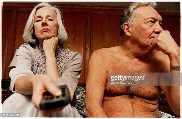 Older Couple Bored of Watching Television