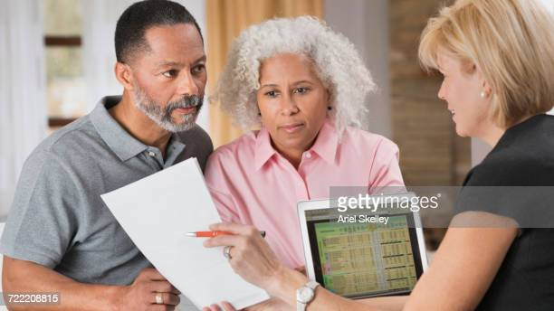 Older couple consulting with financial planner