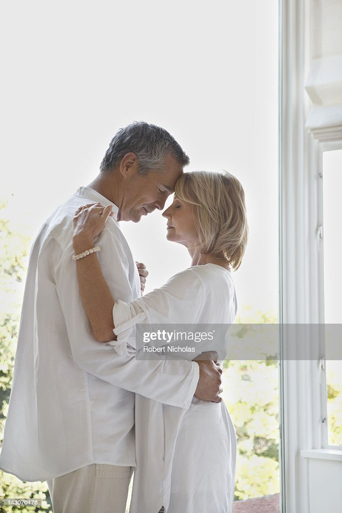Older couple dancing in doorway : Stock Photo