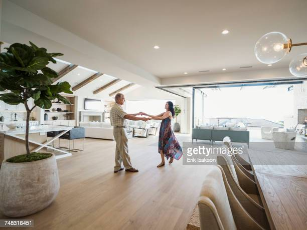 Older couple dancing in modern home
