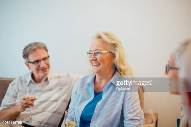 older couple drinking wine - drunk wife at party stock pictures, royalty-free photos & images