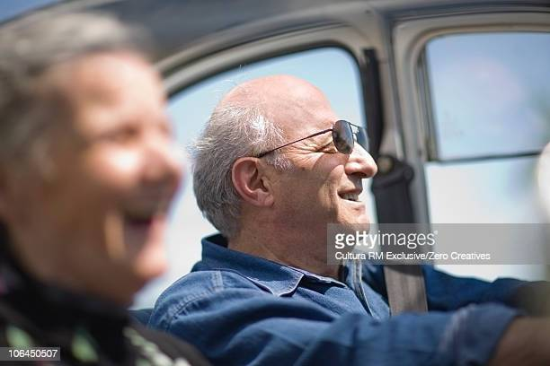 Older couple driving a car