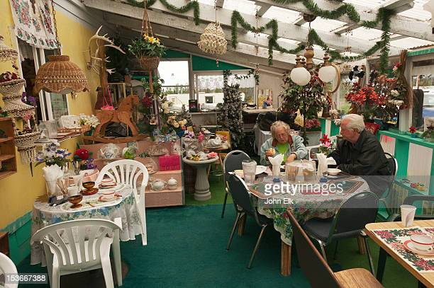 older couple eating at nina's samovar cafe - ca nina stock pictures, royalty-free photos & images