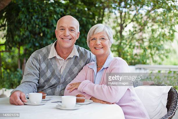 Older couple having coffee together