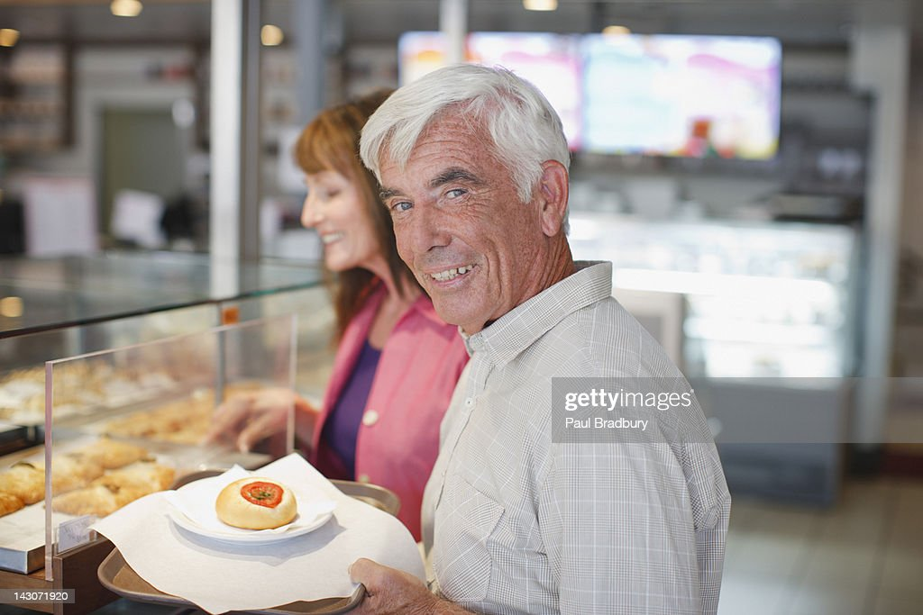 Older couple having lunch in cafe : Stock Photo