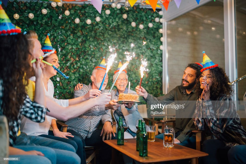 Terrific Older Couple Holding Birthday Cake And Guest Holding Fireworks Personalised Birthday Cards Paralily Jamesorg