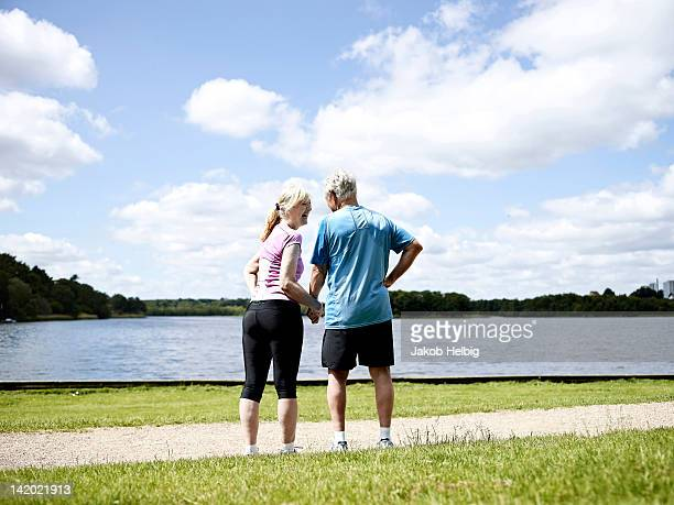 Older couple holding hands outdoors