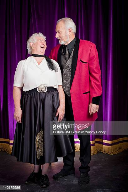 Older couple in dance costume on stage