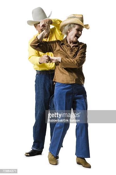 Older couple in western clothing dancing