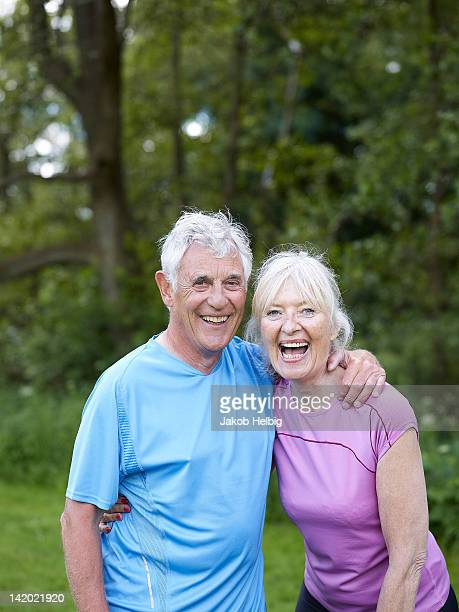 Older couple laughing together in park