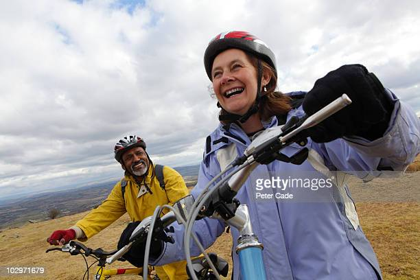 older couple on bikes - cycling helmet stock pictures, royalty-free photos & images