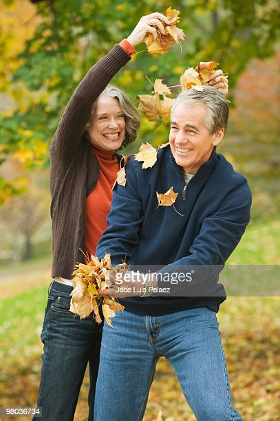Older couple playing with leaves