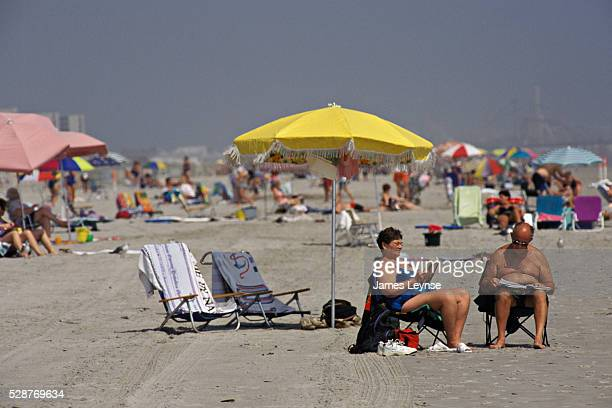 Older Couple Reading at Beach