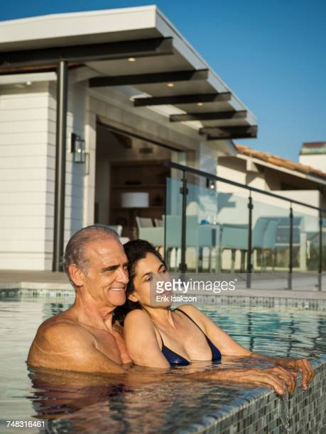 Older couple relaxing in swimming pool
