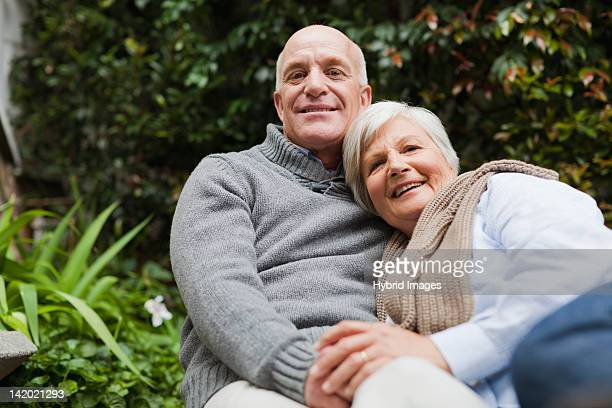 Older couple relaxing together outdoors