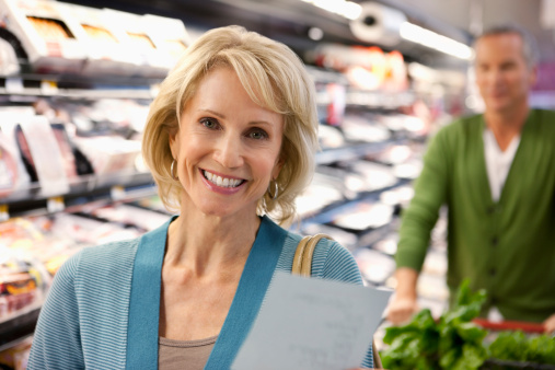 Older couple shopping in supermarket - gettyimageskorea