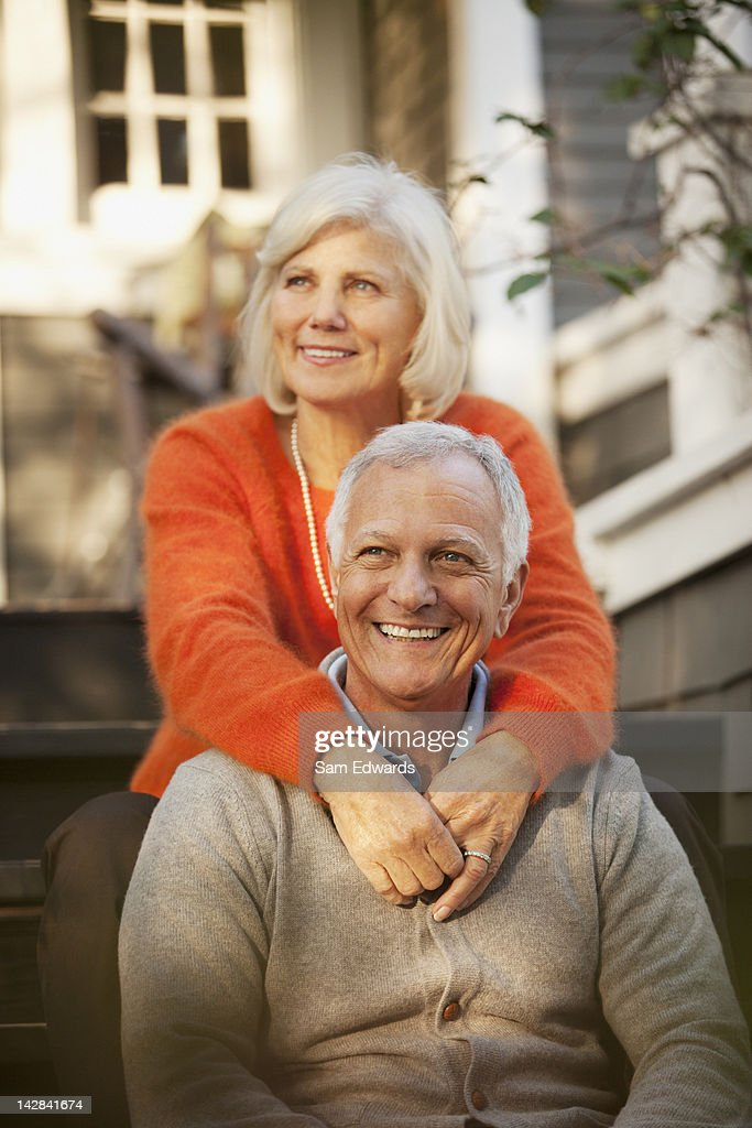 Older couple sitting on steps outdoors : Bildbanksbilder