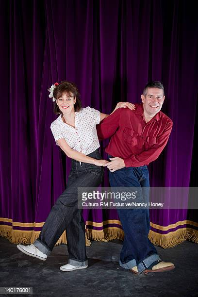 Older couple standing on stage