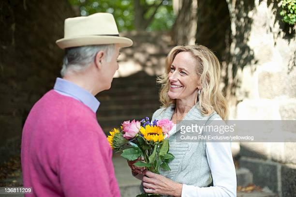 Older couple talking in park