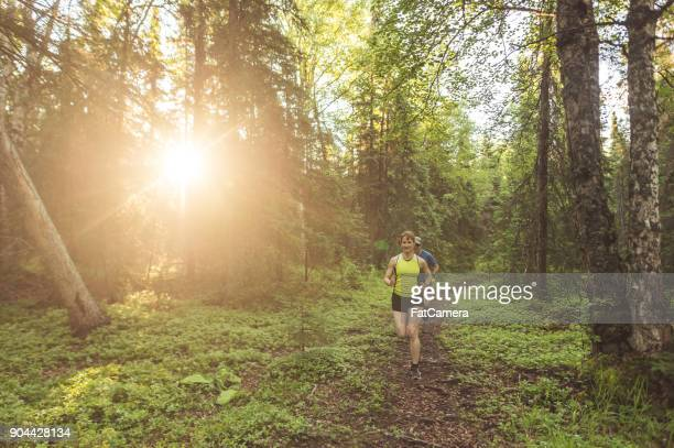 Older Couple Trail Running in Forest
