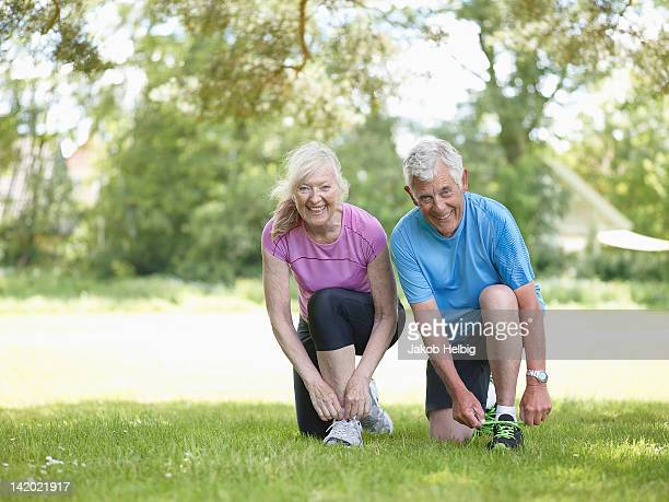 Older couple tying their shoelaces