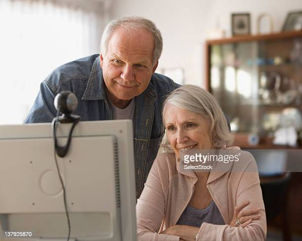 older couple using webcam - webcam stock photos and pictures