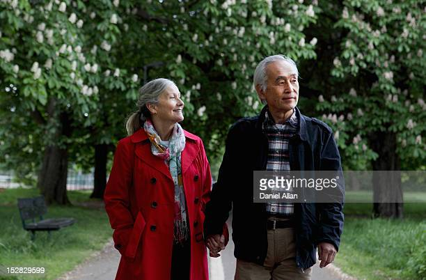 Older couple walking in park