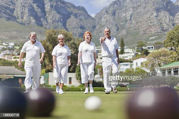 Older couples lawn bowling