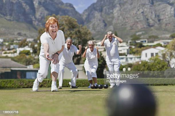 Older couples playing lawn bowling