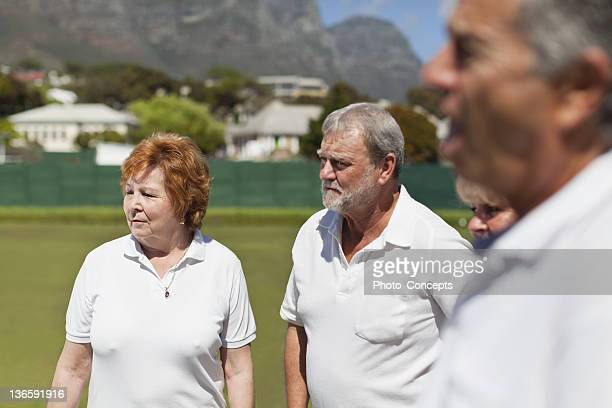Older couples standing outdoors