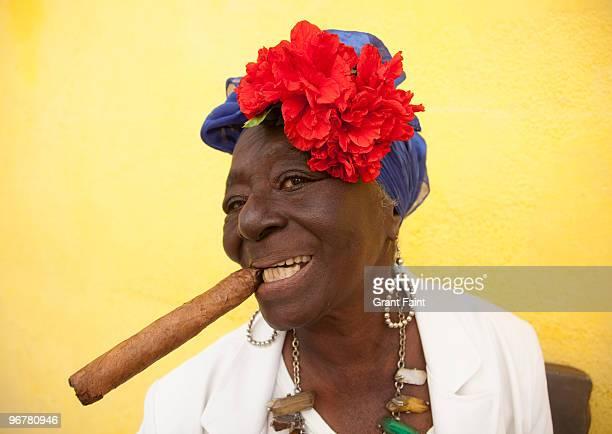 older cuban women posing with cigar