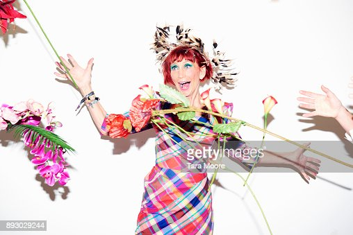 older fashionable woman catching flowers
