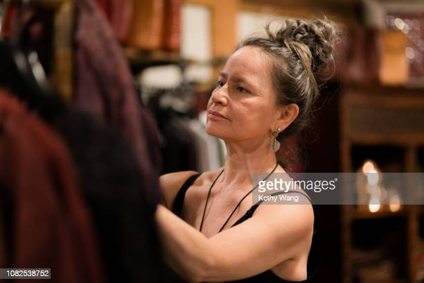 Older fashionable woman selecting clothes