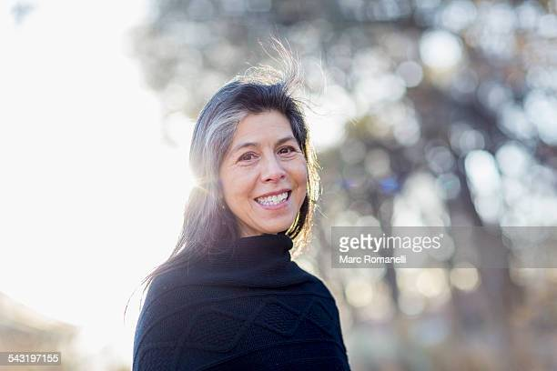 Older Hispanic woman smiling outdoors