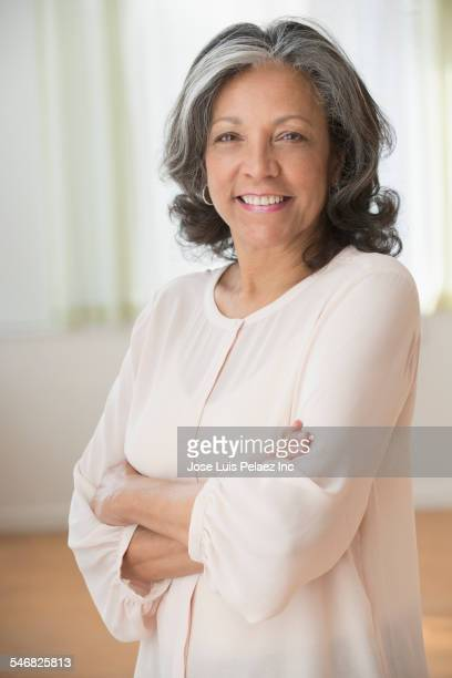 older hispanic woman smiling - beautiful puerto rican women stock photos and pictures
