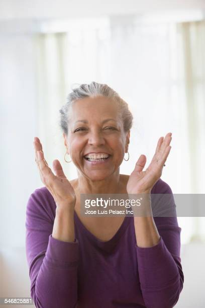 older hispanic woman smiling - one senior woman only stock pictures, royalty-free photos & images