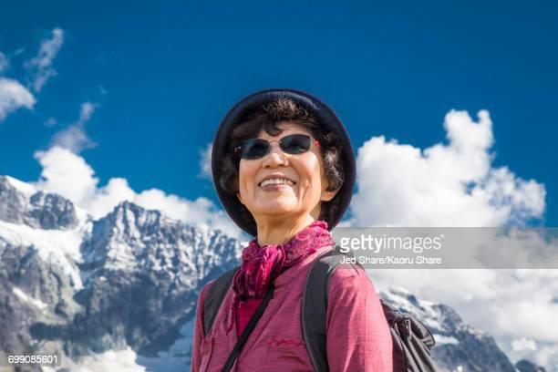 older japanese woman smiling near mountain - 80代 ストックフォトと画像