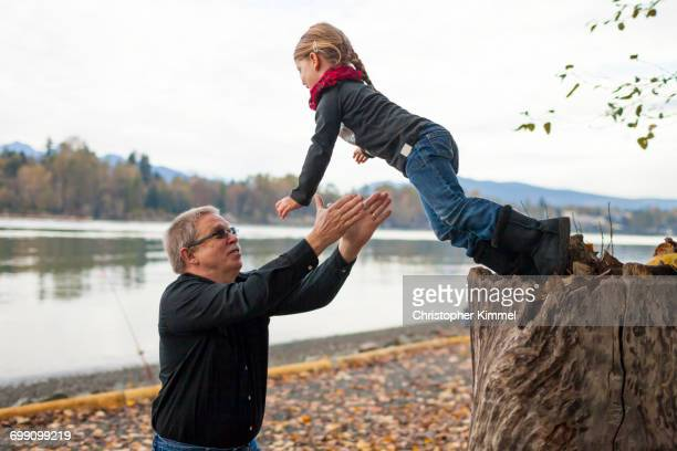 A older man catches his granddaughter.
