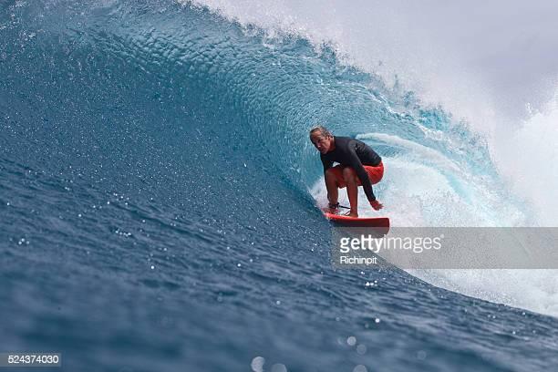 Older man gets barreled on a wave in style