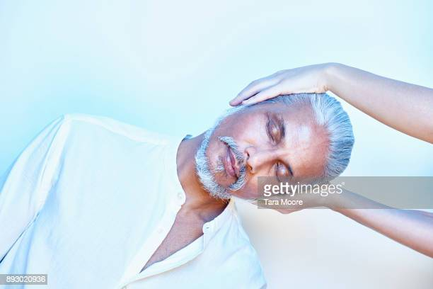 older man getting head massage