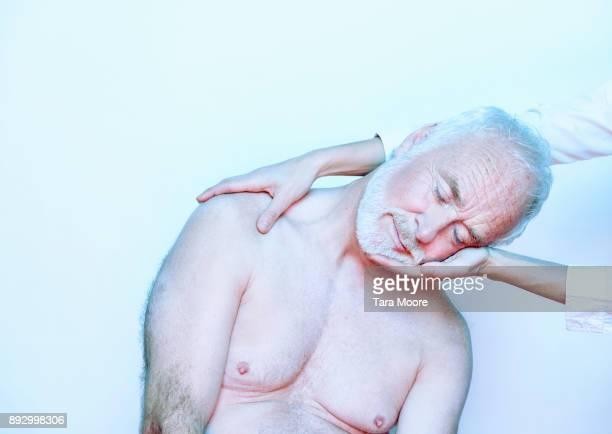 older man getting massage