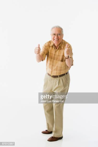 Older man giving thumbs up to the camera
